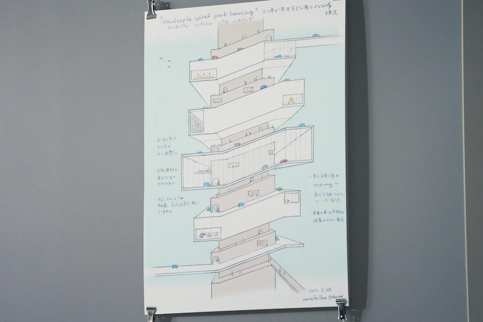 モビリティ用のレーンと住戸のレーンが多重螺旋を描く岡野さんの住宅建築のアイデア。人とモビリティの共生という未来的なテーマが感じられる。